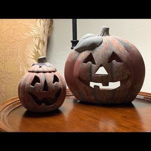 Two carved clay pumpkins